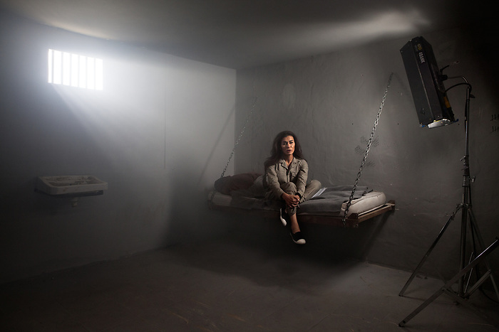"Shooting of the series ""Jareemat Shaghaf"" (""Passionate Crime""), Lebanon mars 2016 (Media 7 revolution). The lebanese star Nadine El Rasi plays the role of a prisoner. In the story, she is accused of having killed her husband, who in fact committed suicide after an unfortunate misunderstanding in the first episode. For the scene, the actress prefered to keep her beauty make up, the style being more important than realism for her.<br /> <br /> Tournage de la série ""Jareemat Shaghaf"" (""Crime Passionnel"") Liban, Mars 2016 (Media revolution 7). La star libanaise Nadine El Rasi incarne le personnage d'une prisonnière. Dans l'intrigue, la belle prisonnière est accusée d'avoir assassiné son mari, qui s'était en fait suicidé sur un malentendu dans le premier épisode. Pour la scène, l'actrice préfère conserver son maquillage beauté à celui de prisonnière, privilégiant le style au réalisme du rôle."