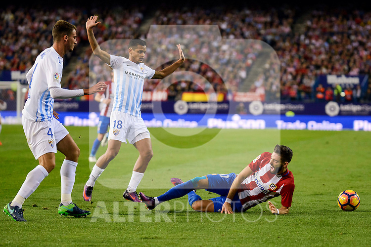 Atletico de Madrid's player Yannick Carrasco and Malaga CF Mikel Villanueva Alvarez and Roberto Jose Rosales during a match of La Liga Santander at Vicente Calderon Stadium in Madrid. October 29, Spain. 2016. (ALTERPHOTOS/BorjaB.Hojas)
