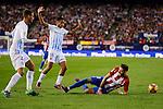 Atletico de Madrid's player Yannick Carrasco and Malaga CF Mikel Villanueva Alvarez and Roberto Jose Rosales during a match of La Liga Santander at Vicente Calderon Stadium in Madrid. October 29, Spain. 2016. (ALTERPHOTOS/BorjaB.Hojas)