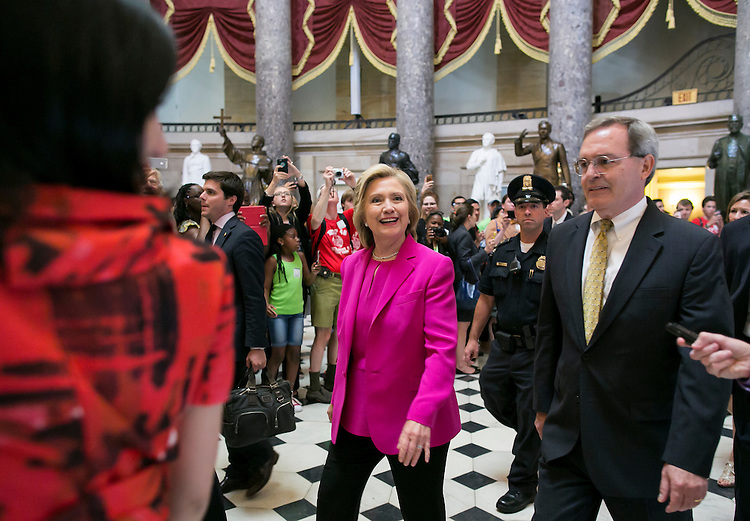 UNITED STATES - JUNE 14 - Presidential candidate Hillary Clinton greets tourists as she makes her way through the Capitol after leaving the Democratic Senate Policy luncheon in Washington, Tuesday, July 14, 2015. (Photo By Al Drago/CQ Roll Call)