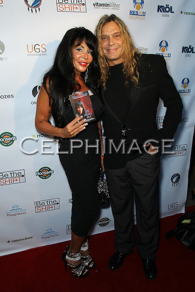 DAWN CHRISTIE, JOHNNY CHRISTIE. Red Carpet arrivals to the launch event of Be The Shift at Industry Night Club. West Hollywood, CA, USA. 6/14/2010..