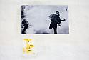 A photograph of a masked demonstrator pasted to a wall in the avenue Victor Hugo during the Rencontres de la Photographie, Arles, July 9, 2016. &copy; Carlo Cerchioli<br /> <br /> Una fotografia di un dimostrante mascherato &egrave; incollata su di un muro in avenue Victor Hugo durante i Rencontres de la Photographie, Arles, 9 luglio 2016.