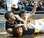 SIOUX FALLS, SD - FEBRUARY 1:  Brett Stanley #12 from Washington battles for the ball with Spencer Hanson #34 from Sioux Valley in the first quarter of their game Saturday afternoon at the Sanford Pentagon. (Photo by Dave Eggen/Inertia)
