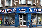 Street sign in English and Bengali and Asian clothing shop , Brick Lane, London, E1, England