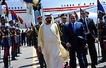 A handout picture released by the Egyptian Presidency shows Egyptian President Abdel Fattah al-Sisi walking with United Arab Emirates Prime Minister and Dubai Ruler Sheikh Mohammed bin Rashid al-Maktoum, upon his arrival to attend he Egypt Economic Development Conference in Sharm el-Sheikh, March 13, 2015. The conference, opening Friday, is the government's centerpiece for showing that the country is ready for business. President Abdel-Fattah el-Sissi has staked much of his legitimacy on fixing an economy deeply damaged by four years of turmoil. Photo by Egyptian Presidency
