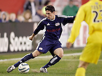 The New England Revolution's Jay Heaps crosses a ball into the middle as David Testo of the Columbus Crew watches. The New England Revolution defeated the Columbus Crew 3 to 0 during the Revolution's MLS home opener at Gillette Stadium, Foxboro. MA, on Saturday April 9, 2005.