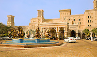 Dubai.  Al Qasr Hotel, front entrance and fountain of superb luxury hotel built in the style of a Moroccan Palace..