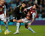 Joao Cancelo of Manchester City tackled by Henri Lansbury of Aston Villa  during the Premier League match at Villa Park, Birmingham. Picture date: 12th January 2020. Picture credit should read: Darren Staples/Sportimage