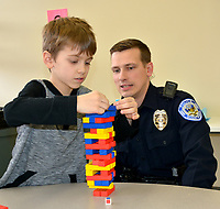Janelle Jessen/Herald-Leader<br /> Zachery Calcott, a student at Southside Elementary School, plays a game of Jenga with Josh Fritz, a school resource officer with the Siloam Springs Police Department. The pair are part of the Bigs with Badges program being piloted at Big Sisters Big Brothers of Siloam Springs.