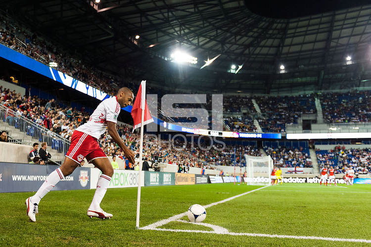 Thierry Henry (14) of the New York Red Bulls takes a corner kick. The New York Red Bulls defeated Toronto FC 4-1 during a Major League Soccer (MLS) match at Red Bull Arena in Harrison, NJ, on September 29, 2012.