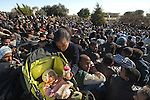 A mother gives her baby a bottle of milk, as African asylum-seekers protest in front of the Knesset, Israel's parliament in Jerusalem, calling the government to recognize them as refugees and to release those Africans who are held in detention facilities.