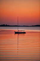 Sailboat at sunset, Cape Cod, MA, Massachusetts, USA