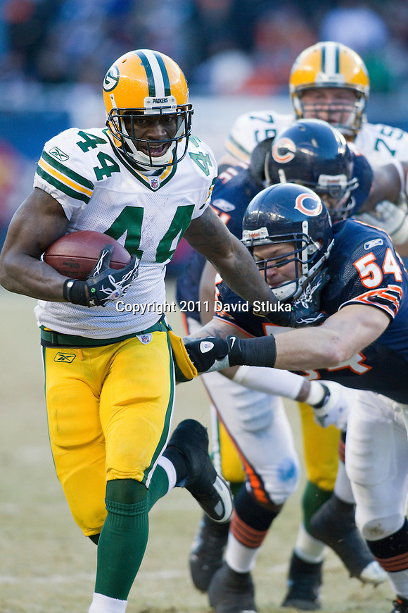 Green Bay Packers running back James Starks (44) stiff arms Chicago Bears linebacker Brian Urlacher (54) during the NFC Championship NFL football game at Soldier Field in Chicago on January 23, 2011. The Packers won 21-14. (AP Photo/David Stluka)