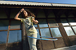 Elsa Gashi, a 12-year old refugee from Kosovo, plays with a hula hoop in a government-run refugee center in Vamosszabadi, Hungary. Hungarian Interchurch Aid, a member of the ACT Alliance, provides child care and other services to residents in the center, who come from Syria, Iraq and other countries and are bound for western Europe.