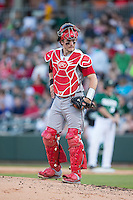 North Carolina State Wolfpack catcher Andrew Knizner (11) looks to the dugout as he walks out to the mound during the game against the Charlotte 49ers at BB&T Ballpark on March 31, 2015 in Charlotte, North Carolina.  The Wolfpack defeated the 49ers 10-6.  (Brian Westerholt/Four Seam Images)