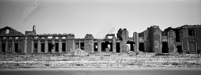 Bombed out ruins line the road. Kabul, Afghanistan. July, 2003.