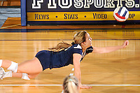13 November 2010:  FIU's Chanel Araujo (13) attempts to dig the ball in the first set as the FIU Golden Panthers defeated the South Alabama Jaguars, 3-0 (25-12, 25-12, 25-20), at U.S Century Bank Arena in Miami, Florida.