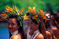 Head and shoulder shot of beautiful Tahitian dancers wearing bird of paradise haku leis.