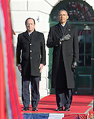 United States President Barack Obama listens to the National Anthem as he welcomes President Francois Hollande of France for a State Visit on the South Lawn of the White House in Washington, D.C. on Tuesday, February 11, 2014.<br /> Credit: Ron Sachs / CNP