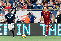 FOXBOROUGH, MA - SEPTEMBER 21: Aaron Herrera #22 of Real Salt Lake dribbles during a game between Real Salt Lake and New England Revolution at Gillette Stadium on September 21, 2019 in Foxborough, Massachusetts.
