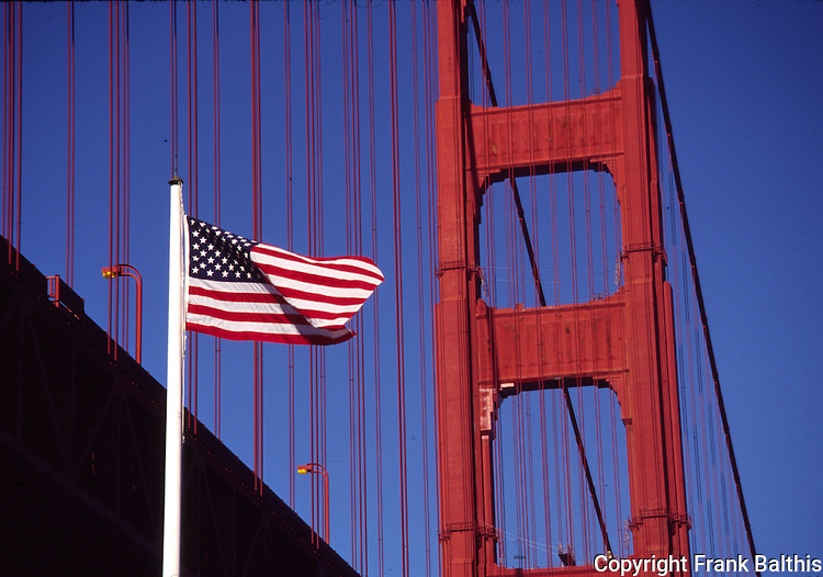 American flag at Fort Point with Golden Gate Bridge
