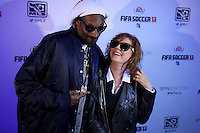 "Snoop Dogg now known as Snoop Lion poses with American actress Susan Sarandon while they attend an event organized by MLB and EA Sports for launching the last soccer game named ""FIFA Soccer 13"" in New York . Photo by Eduardo Munoz Alvarez / VIEW."