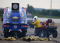 May 21, 2016; Topeka, KS, USA; NHRA safety safari put out an engine fire to the car of funny car driver Robert Hight during qualifying for the Kansas Nationals at Heartland Park Topeka. Mandatory Credit: Mark J. Rebilas-USA TODAY Sports