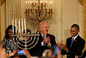 Israeli President Reuven Rivlin (2R), US President Barack Obama(R), US First Lady Michelle Obama (L), and Nechama Rivlin, the wife of Reuven Rivlin (2L) applause during a Hanukkah reception in the East room of the White House, in Washington, DC, December 9, 2015. <br /> Credit: Aude Guerrucci / Pool via CNP
