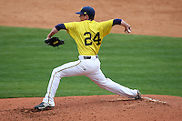 March 21, 2010:  Pitcher Tyler Burgoon (24) of the Michigan Wolverines delivers a pitch during a game at Tradition Field in St. Lucie, FL.  Photo By Mike Janes/Four Seam Images
