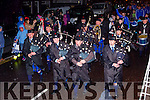 The Killorglin Pipe Band lead the St Marys team and AIB Intermediate Club Champions into Cahersiveen on Sunday evening.