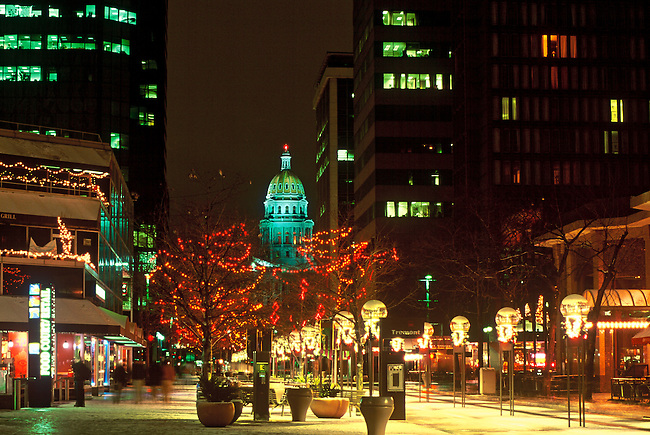 Christmas decorations line the 16th Street Mall in downtown Denver with the dome of the Colorado State Capitol building in the background.