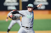 Marshall Thundering Herd relief pitcher Alex Thackston (18) delivers a pitch to the plate against the Georgetown Hoyas at Wake Forest Baseball Park on February 15, 2014 in Winston-Salem, North Carolina.  The Thundering Herd defeated the Hoyas 5-1.  (Brian Westerholt/Four Seam Images)