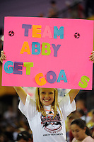 A team Abby XI fan holds up a sign during the Women's Professional Soccer (WPS) All-Star Game at KSU Stadium in Kennesaw, GA, on June 30, 2010.