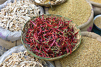 Red chillies, cardamom, coriander and dried mango skins on sale at Khari Baoli spice and dried foods market, Old Delhi, India