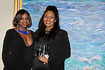 Color of Beauty Awards - Nicole Ferrell - Trophy Girl presents Jordan Tesfay (Covergirl Model) with the Model of the Year award on February 28, 2015 with red carpet, awards and cocktail reception at Ana Tzarev Gallery, New York City, New York.  (Photo by Sue Coflin/Max Photos)
