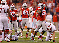 Ohio State Buckeyes defensive tackle Michael Bennett (53) celebrates his sack of Wisconsin Badgers quarterback Joel Stave (2) in the second quarter of the Big Ten Championship game at Lucas Oil Stadium in Indianapolis on Saturday, December 6, 2014. (Columbus Dispatch photo by Jonathan Quilter)