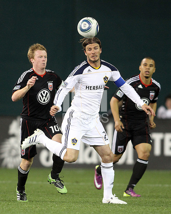 Dax McCarty (10) and Charlie Davies (9) of D.C. United  behind David Beckham (23) of the Los Angeles Galaxy during an MLS match at RFK Stadium, on April 9 2011, in Washington D.C.The game ended in a 1-1 tie.
