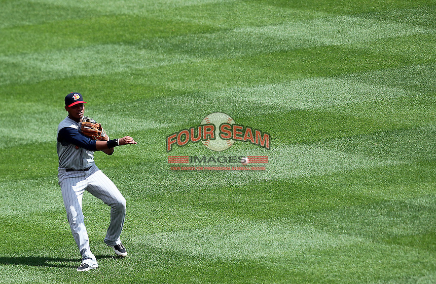 Toledo Mudhens shortstop Argenis Diaz #11 throws to first from the outfield grass during a game against the Buffalo Bisons at Coca-Cola Field on August 17, 2011 in Buffalo, New York.  Buffalo defeated Toledo 4-2.  (Mike Janes/Four Seam Images)