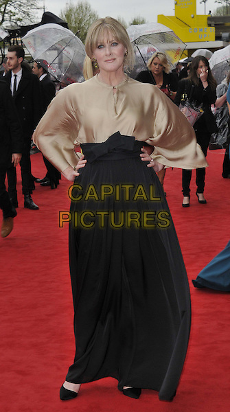 Sarah Lancashire.Arqiva British Academy Television Awards in 2013 at the Royal Festival Hall, London, England..12th May 2013.BAFTA BAFTAS full length brown gold silk satin blouse black flared wide leg trousers hands on hips.CAP/DS.©Dudley Smith/Capital Pictures