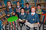 Enjoying the selection of books at the new library at Scoil Eoin Balloonagh. .Front L-R Brian Votta and Josephine Carey. .Back L-R Roisin Harte, Michalina Gora, Brian McElligott and David Christie. ..
