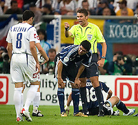 Referee Roberto Rosetti warns Serbia & Montenegro players against rough play. Argentina defeated Serbia and Montenegro 6-0 in their FIFA World Cup Group C match at FIFA World Cup Stadium, Gelsenkirchen, Germany, June 16, 2006.