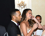 John Legend and Chrissy Teigen poses at the 71st Annual Tony Awards, in the press room at Radio City Music Hall on June 11, 2017 in New York City.