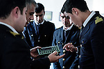 Baku - Azerbaijan - 08 December 2014 -- Azerbaijan State Marine Academy. -- Instructor and teacher Sadigov Asaf during a lesson on Global maritime distress safety Systems showing to students Guliyev Ismail (20), Mehdiyev Mehemmed (20), Tairov Samir (20) and Osmanli Ekhtiram (20) how a Navtex receiver works. -- PHOTO: Sitara Ibrahimova / EUP-IMAGES