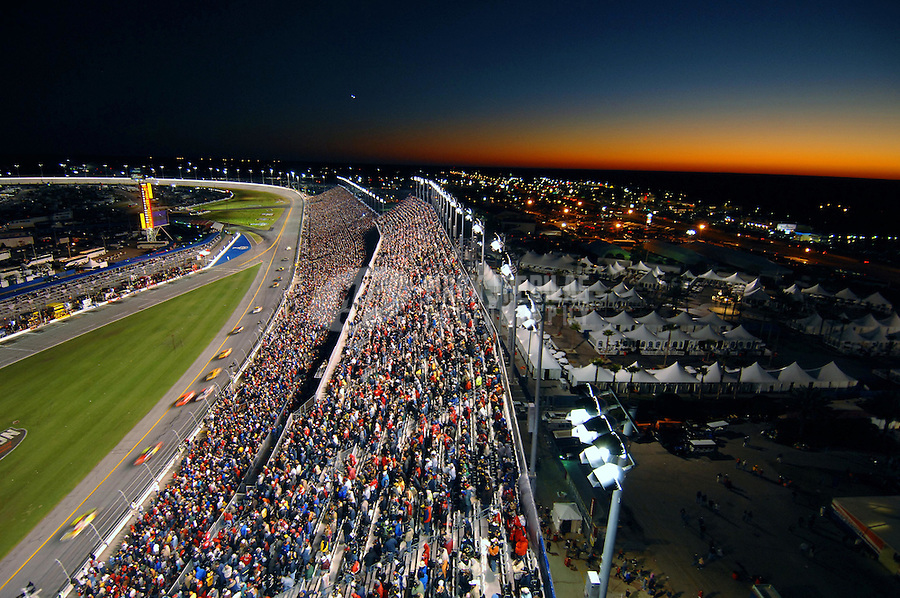 Feb 18, 2007; Daytona, FL, USA; Nascar Nextel Cup Series drivers race as the sun sets during the Daytona 500 at Daytona International Speedway. Mandatory Credit: Mark J. Rebilas