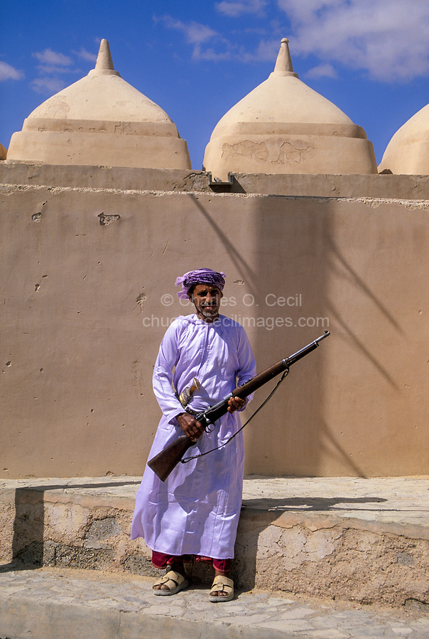 Jalan Bani Bu Ali, Oman.  Mosque Guardian with his Rifle and Khanjar, Mosque of Rashid bin Hamouda.