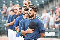 Carlos Sanchez (7) of the Columbia Fireflies stands with his team for the National Anthem before a game against the Charleston RiverDogs on Monday, August 27, 2018, at Spirit Communications Park in Columbia, South Carolina. Charleston won, 4-0. (Tom Priddy/Four Seam Images)