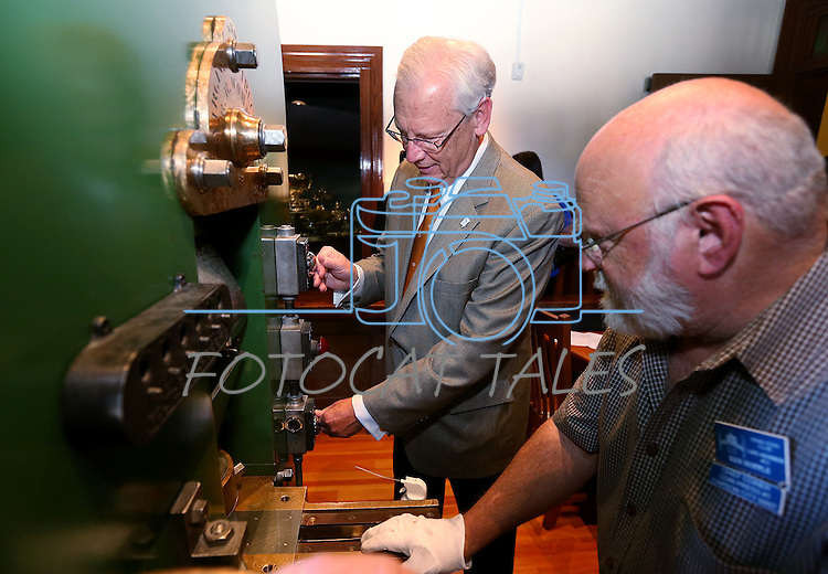 Coiner Ken Hopple watches Bud Hicks mint a medallion of the fourth and final in a commemorative Sesquicentennial series at the Nevada State Museum, in Carson City, Nev., on Wednesday, Sept. 3, 2014. <br /> Photo by Cathleen Allison