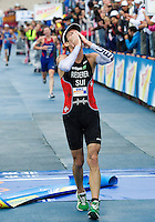 10 SEP 2011 - BEIJING, CHN - Sven Riederer (SUI) celebrates taking second place at the 2011 Elite Mens ITU World Championship Series Grand Final Triathlon (PHOTO (C) NIGEL FARROW)