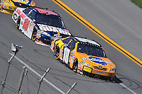 Apr 26, 2009; Talladega, AL, USA; NASCAR Sprint Cup Series driver Kyle Busch (18) leads Dale Earnhardt Jr during the Aarons 499 at Talladega Superspeedway. Mandatory Credit: Mark J. Rebilas-