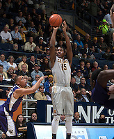 Jordan Mathews of California shoots the ball during the game against Washington at Haas Pavilion in Berkeley, California on January 15th 2014.  California defeated Washington, 82-56.